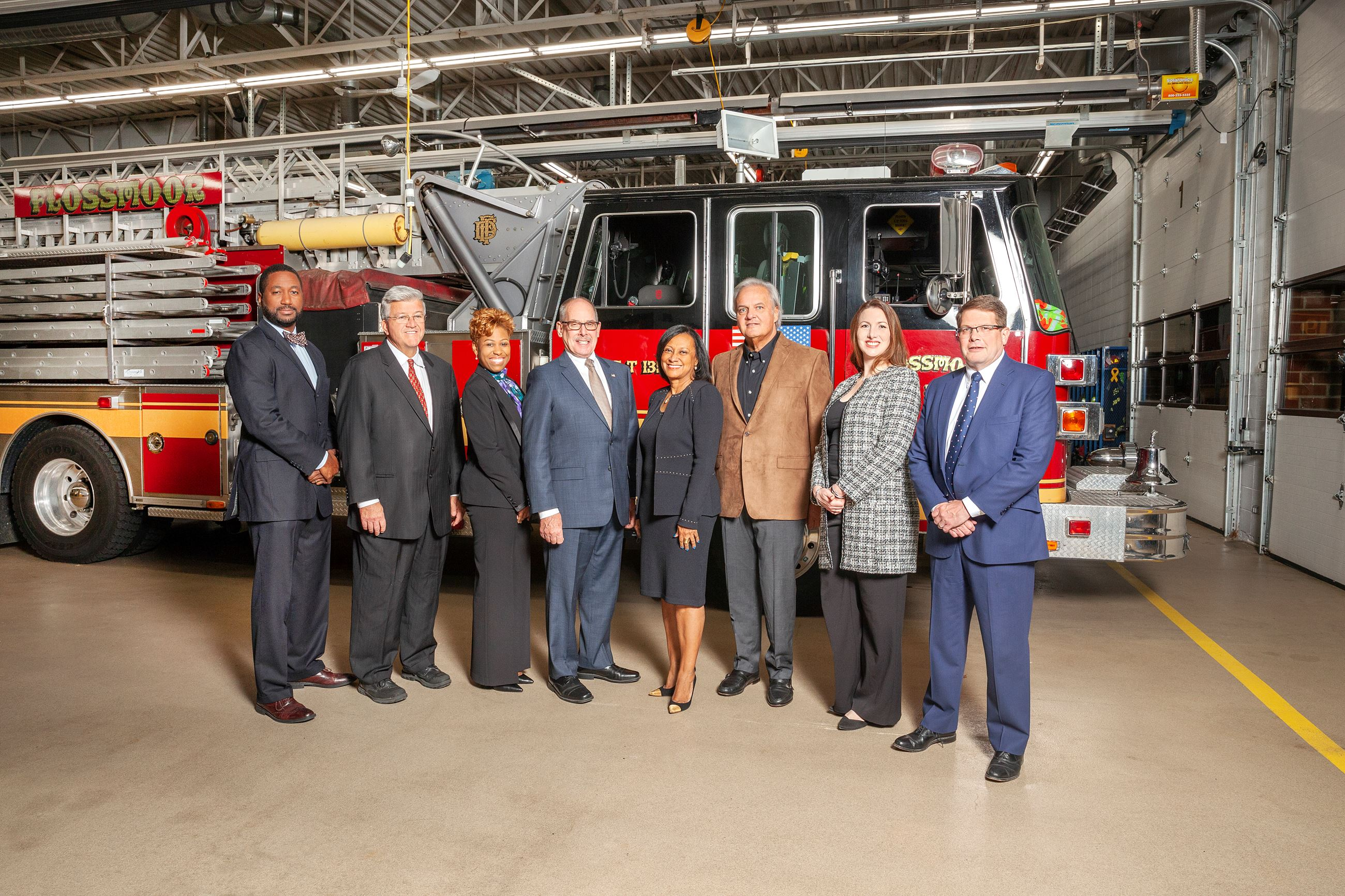 Photo of Mayor, Board of Trustees and Clerk in Front of Fire Truck
